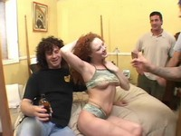 Redhead Slut Fucks Two Studs