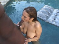 Busty Redhead Leah Sucks Black Cock In The Pool