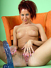 Redhead Masturbates With a Dildo